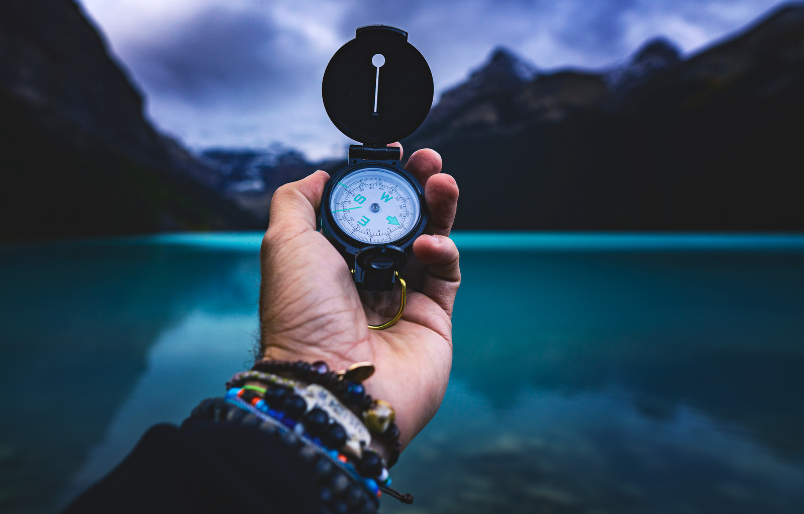Canva - Person Holding A Compass